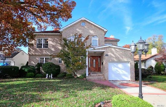 WOW! 30 Foot Ceilings, Breathtaking Grand Entrance. Recently Renovated Custom Built Colonial with 3000+ Sq Ft of Living Space PLUS a 780 Sq Ft Finished Basement. Gourmet Kitchen w/ Granite Counters, 1st Floor Guest Suite w/ Full Bath and WIC, 2nd Floor Master w/ Full Bath, WIC & Huge Terrace, High Ceilings Throughout, 4 Skylights. Finished Basement w/ Laundry, Addtl Room, Full Bath, WIC & OSE. Large Back Yard, East Meadow Schools. *Tax Grievance Filed Anticipated Reduction 2020*