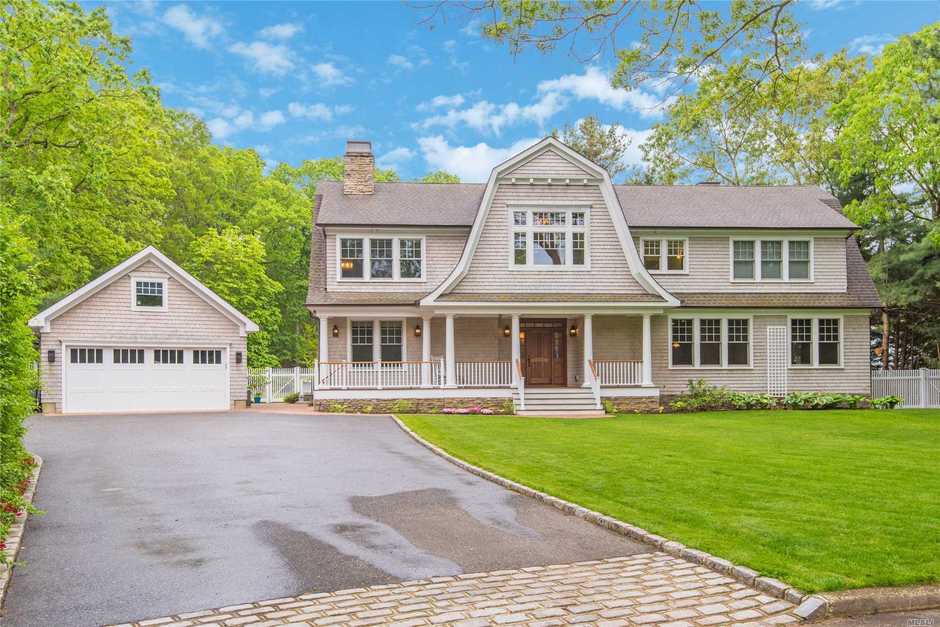 Like New Hampton Style Custom Built Home With Exceptional Details and Amenities.This One Of A Kind Magnificent Property Features A Fabulous Gourmet Kitchen that Opens To A Great Room With High Ceilings Overlooking The Stunning Back Yard With An In Ground Heated Pool.The Master Suite Has A Huge Walk In Closet.Gas Fireplace and A Beautiful Master Bath. Ipe Wood Porches Surround This Stunning Home, Detached Over Sized Garages, Award Winning Half Hollow Hills Schools, Perfect Cul De Sac Location