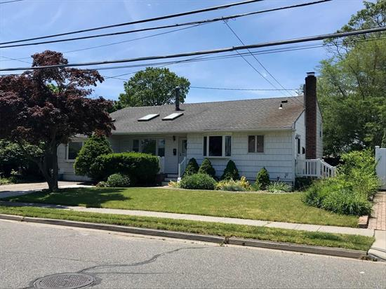 Expanded split on quiet block features two full baths, four bedrooms, living room with fireplace, large family room with loft and room for Mom. Immediate occupancy. Don't wait .. it will not last!!!