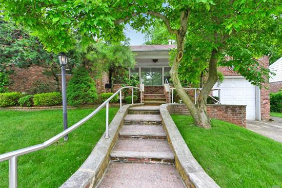 Very Well Maintained Brick Ranch House, Updated Kitchen and All 3 Bathrooms. Formal Dining Room. Hardwood Floors, Cozy Gas Fireplace, Full Finished Basement with Wet Bar, Bedroom, Laundry and Lots of Storage Space. Beautiful Back-Yard, In-ground Sprinkler System, Attic for Storage and much more. P.S 188, Public Transportation and Shopping are all around the corner.