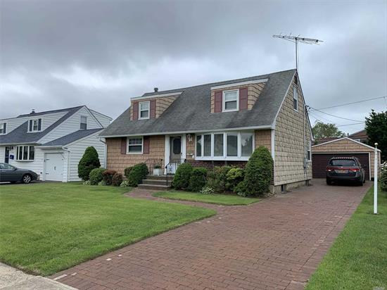 Lovely half dormered 3 bedroom cape with two full baths, Full partially finished basement, Wood floors under carpet, 150 amp electric service with generator connection (generator not inc) extra large 1 car garage, covered cement patio. Brick paved the driveway. Vinyl fenced rear yard.