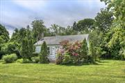 Charming 1950's Cottage on a beautiful .45-acre lot backing onto preserved fruit orchards, a short walk to town bay beach. Wood burning fireplace, hardwood floors throughout, original knotty pine cupboards in kitchen, full basement, freshly painted inside and out. Beautiful setting with room for a pool and to expand. Walking distance to Jitney & grocery.