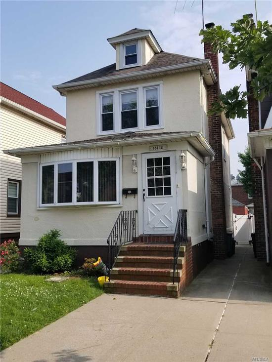 Detached 3 Bdrm Colonial in Prime Flushing North Location! This house is conveniently located with walk to Bowne Park, Northern Blvd, Buses, LIRR, Shopping, Restaurants & more.. Only minutes ride to Downtown Flushing & 7 Train. There is a Sun-filled yard w. new vinyl fence & wooden deck flooring. A spacious Formal Din Rm makes it ideal for Large family dinners or entertaining. The stand up attic offers plenty of storage and the basement has a separate side entrance. Hurry!