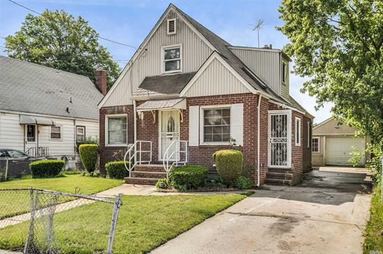 A Charming & Elegant Cape featuring 4 Bedrooms, 2 Full Bathrooms, 2 Car Garage, Full Finished Basement,  Kitchen, Over sized Backyard and Lots More. The Owner has made tons of Updates throughout - Great Opportunity for a Ready-To-Move in