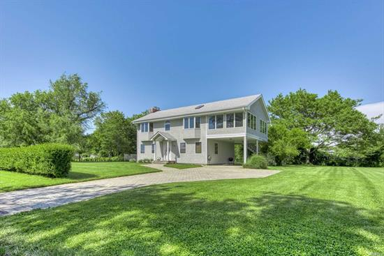 This Post-Modern Home is spacious and bright with 3 bedrooms and 3 baths on Willow Terrace in Orient Village. Just a short walk to private deeded bay front beach. Offering wood burning fireplace, bay views from second floor, large sun room, outdoor shower and carport. This .56-acre lot offers unique privacy and room for a pool.