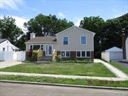 Spacious split level ranch , hardwood floors, park like grounds, private driveway and garage. A must see