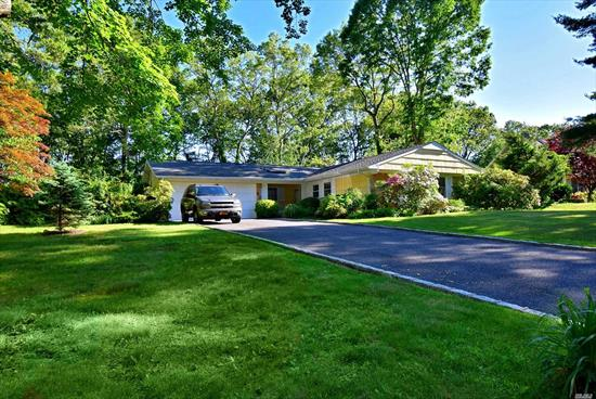 Beautiful home in the S-Section of Stony Brook.  Three nice size Bedrooms, two updated Full Bath, Two Car Garage with very Private Yard. Patio over looks lush gardens with fenced yard.  Yard is larger then appears in pictures