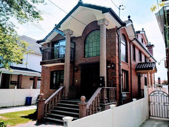All Brick legal 2 family Located at heart of Flushing. In Excellent Condition with High Quality Materials. High ceiling, Hardwood FL, Close to ALL.