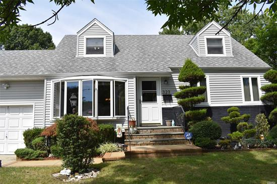 Welcome home to this Expanded Cape Cod style home, a large Kitchen anchors this 4 Bedroom, 2 Bath home located just close enough to the LIRR & local parks & ball fields, finished Basement w/Family Room, yard features AG pool surrounded by raised deck & screened in porch, move in, sit back & enjoy your summer oasis.