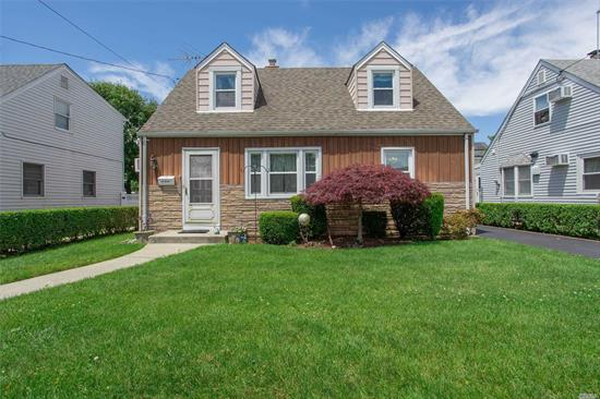 Charming House on Tree Line Street with 4 Bedrooms, 1 Full Bath, HW Floors, Gas Heat, Enclosed Porch and Detached Garage. Amazing Location, School District #24, 34 Minute Commute to Manhattan. Close to LIRR, Schools, Park and Shopping. Low Taxes. Needs TLC!