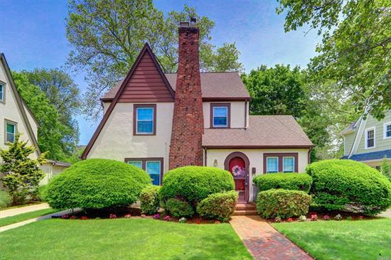Lovely well maintained Tudor located on an oversized lot of 60 X 140 square feet in Cathedral Gardens. Entrance foyer leads into spacious living room with fireplace, oversized dining room, den, kitchen with breakfast nook, powder room and screened in porch. Hard floors throughout and the home has beautiful moldings throughout, hardwood floors etc.  Truly a comfortable home to live in!