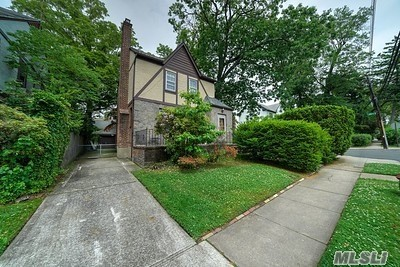New to Market. Corner lot Tudor in a very private area of Bayside.
