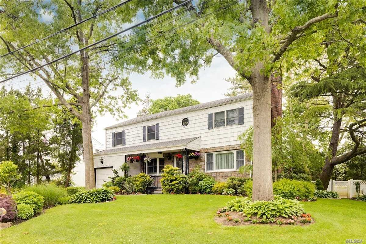 Magnificent Central Hall Colonial on quiet centrally located block in Woodmere (not in flood zone). 5 bedrooms and 3 baths on the 2nd floor, full finished basement,  dream kosher kitchen, CAC, 78x100 lot.