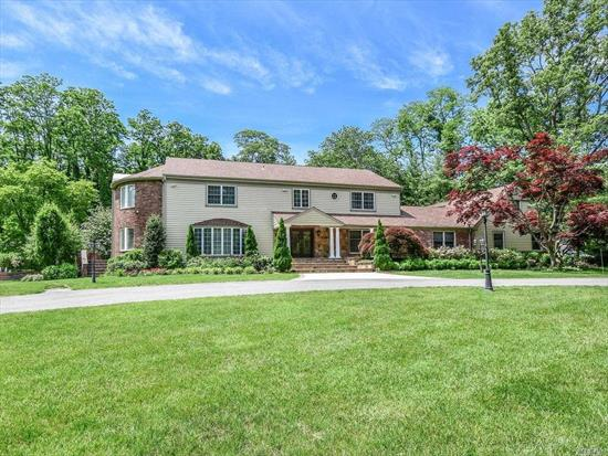From the lushly landscaped private 2 acre grounds to the spacious and sun-drenched rooms, this majestic home is elegantly appointed for entertaining. The Entry Foyer with grand staircase and gold inlay floor will lead your guests to the sophisticated upper level. The Den and Florida Room, share a fireplace, The professional-grade EIK is fully equipped with high-end appliances. See attached sheet for specific details.