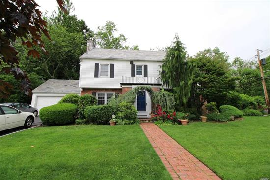 Lovely New Canterbury Colonial Features: Entry Foyer With 2 Closets, Large Living rm with Fireplace, Formal Dining, Eik, Large Den Leading to Spacious Backyard. Bedroom & Full Bath on Separate Side of the House Can Be Used For Professional or Nanny . Full Basement W/ High Ceiling. 2nd Floor: Large Hall With Window Seat, Master Suite W/Walk in Closet, Two Large Bedrooms and Full Bath. Hardwood floor Throughout, Lovely Plaster Crown Molding. Two Car Garage, Slate Roof, Spectacular Backyard!