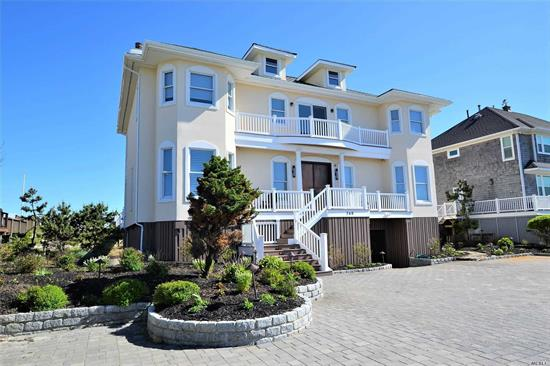 Water Views From Every Room! This completely renovated home is your dream summer getaway! Grand Entry Foyer leads Open Concept LR with FP, DR and Eat-In Chef's Kitchen with all the amenities & with sliders to deck & outstanding Ocean Views. First Flr office & Jr Mstr with Bay Views. Upstairs Mstr BR Suite with FP and Jr Mstr Suite both with Balconies & Ocean Views. Third Upstairs En Suite w/Bay Views & Balcony. Lwr Level Game Rm and Prep Kitchen. Ig heated pool, hot tub & pvt beach access