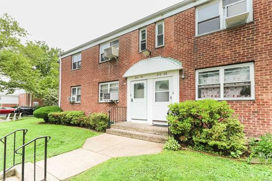 Stunningly Renovated 1 Bedroom in the Heart of Bayside! New and Modern,  Wood Floors, Quartz Counter Tops, Renovated Bathroom., Stainless Steel Appliances and Open-Kitchen Concept! Full attic storage and brand new washer-dryer! Minutes from shopping/nightlife and the LIRR on Bell Blvd!