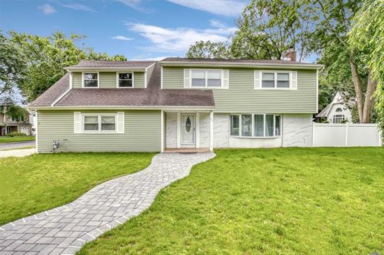 Stunningly renovated Colonial in the heart of Greenlawns award winning Harborfields School District. Featuring 2 Master bedrooms w/en suites, a first floor suite, kitchen with granite counters, and a Full finished basement. This home has it all with views of the park, walking distance to the heart of broadway, and just a short walk to the Greenlawn train station.