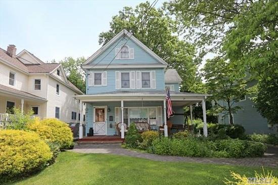 Charming 7 room Colonial in Port Washington features Eat-in- Kitchen w/Stainless Steel appliances, Formal Dining Room, Formal Living Room and Basement with fireplace plus Laundry. Large front porch with long driveway and detached 2-Car garage. Backyard for entertaining- Must See!