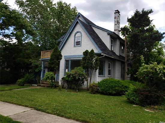 3 Bedroom Tudor On A Corner Lot In A Quiet Neighborhood. Large Principle Rooms. Full Finished Basement. Great Yard. Detached Garage. Lots of Potential With Some TLC!