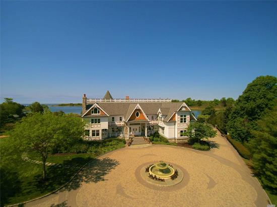 Story Book Mansion on The Champlin River, across from Seatuck Nature Preserve.3 Stories w/ 60' Widows Walk Accessible from 2 Story Master En Suite. Meticulously maintained at all times! Contractors House, No Expense Spared! Gated on Cul-de-Sac with Expansive Circular Driveway. Thoughtfully Positioned on Property for Ultimate Panoramic Water Views. True Chefs Kitchen w/Stone Wall Cooking Station. 50x60 Deep Water Slip w/227'Bulkhead. Enchanted, Magical Home and Property.