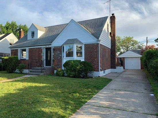 Newly Renovated Cape style home located on a tree-lined street featuring 4 generous bedrooms, 2 full baths, Eat-in Kitchen with center island and stainless steel appliance, Full FInished basement, Private driveway and detached garage