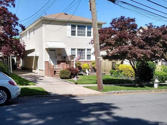 Location, Location.Beautiful maintained detached 2 Family home on tree lined street. Large Living Rooms, Eat in Kitchens, Large Master Bedrooms, Updated Bath on 1st floor, gleaming hardwood floors throughout. Landscaped property. A commuters dream, close to LIRR, bus, shopping.Faces east.