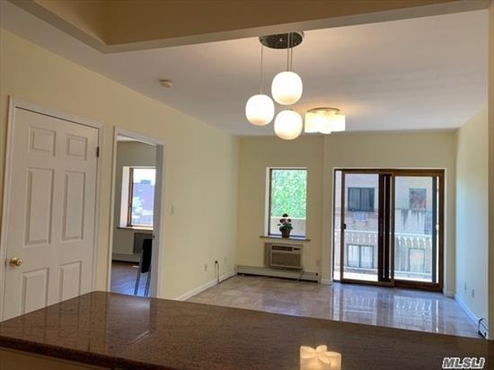 Flushing most desirable location, Corner UNIT w/Balcony, 24 hr doorman , Near #7 Subway & shopping& Restaurant .Com charges incl heating.Mint condition