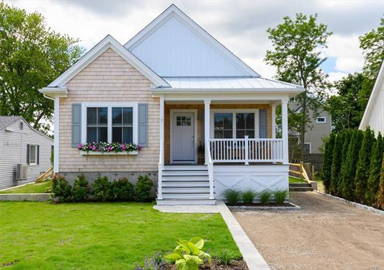 Brand new construction less than 300ft from your private beach! Enjoy one-level living in this custom, 1, 600+sqft ranch w/ cathedral ceilings, exposed beams, ship-lap walls & hardwood floors. Open-concept living rm, dining area, eat-in-kitchen & bonus flex-space affords 'peak' of Peconic Bay. Sprayfoam insulation, energy-efficient windows/doors/mechanicals. Offers custom pantry, laundry rm & large outdoor shower plus rear patio & storage underneath building ideal for kayaks, bikes & beach toys!