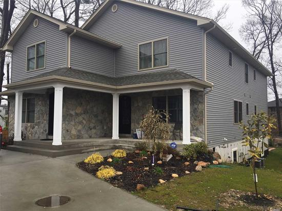 Open Layout With 3 Bedroom And 2.5 Bath. A Private Welcoming Porch Enters Into An Open-Flow First Floor Layout, Complete With Crown Moldings And A custom Kitchen With Stainless Appliances. Sliding Door Leads to a Yard with a Patio. Private Road.
