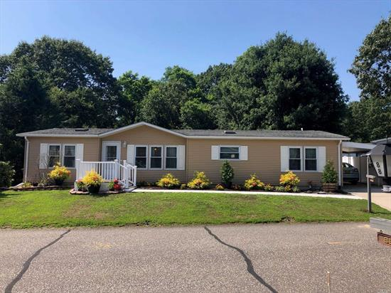 Gated 55+ Manufactured Home Community - Renovated Virginia, 2 Bedroom, 2 Bath, w/ Den, Manuf. Hm. All New Kit, & Baths w/ Silestone Counter-tops & Porcelain Fls, New Nat Gas Heating Sys, Hot Water on Demand, New Sheetrock, Laminate Floors, New Cabinets, Double Hung, Double Pane, Tilt Out Windows & Roof Done in 2012, 200 amp Service, CAC, New Decking with Vinyl Rails. Sprinkler System in Front Yard, Carport - 2 Car Driveway with Private Backyard - Pool, Club House, & Park Area