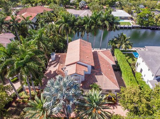 A Gem In Gables By The Sea, A Family Oriented Gated Community. Enter This Radiant Mediterranean Waterfront Home Great For Entertaining And Featuring Spacious And Open Living Areas That Overlook Gorgeous Pool And Canal. Travertine And Wood Floors,  5, 619 Sq.Ft., Six Bedrooms +Office, 7 Bathrooms, Maid Quarters, Elevator, Surround System And An In-Home Movie Theater. Magnificent Eat-In Kitchen, Large Covered Patio With Pool Room And Bathroom, Built In Bar And Travertine Pavers. Living And Family Room Overlook Beautiful And Large Terrace; Master Suite Opens To Breathtaking Views From Balcony; Brick Paved Circular Driveway, 2 Car Garage. At Short Distance To Gulliver, Pinecrest And Palmetto Schools And Close To The Bustling Entertainment Of Sunset Shops In South Miami. Wonderful Location!