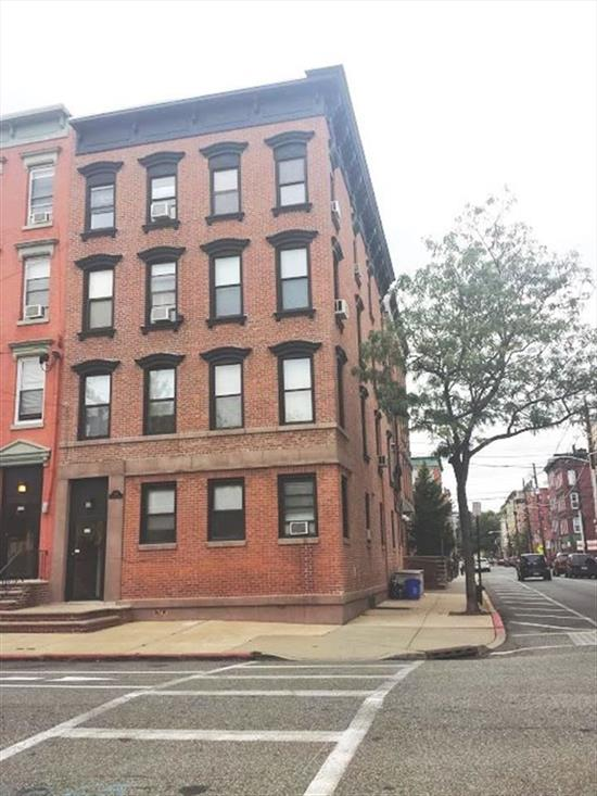 Bright Top Floor Unit. Exposed Brick. Eat in Kitchen with Dishwasher, Newly Renovated Large Bathroom. Tall Ceilings. Laundry in Building. Spacious Rooms. 10 Minute walk to Path. 2 Blocks from NYC Bus. Across from Park and surrounded by Many restaurants. Professionally managed by Red Bridge Construction.