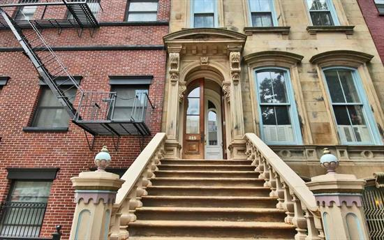 Spacious 2, 376 sf duplex condo located on the parlor level of a true brownstone (not a rowhouse). This 25ft wide architectural jewel was built in 1858! Private off-street parking through Court St. garage entrance. Covered outdoor patio plus yard. Additional storage in basement. 14ft ceilings, original charm, Viking stove, sub-zero refrigerator, and central A/C with humidifier. Large master bedroom with new shower and jacuzzi in bathroom. Best street in the city, 4 blocks from the PATH, & 1 block from Washington Street shops and restaurants. Truly one-of-a-kind! Come to our Open House Saturday, December 9th 2017 from 1:00 to 3:00 pm!