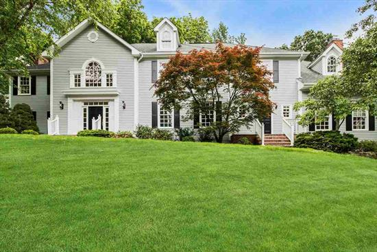 Beautiful 14 room Caplan built colonial located on a private cul de sac. Amazing specialty eat-in chef's kitchen with custom cabinetry, Calcutta Gold Marble countertops and floor to ceiling Calcutta gold subway tiles. Venetian plastered walls. State of the art appliances include 60 Wolf Dual Fuel Range w 6 burners, infrared charbroiler and griddler. Two subzero refrigerators, crisping drawer, beverage drawer and warming oven. Butler Pantry. First floor features state of the art family room open to kitchen with surround sound entertainment experience and gas fireplace. office w builtins, diningroom and livingroom w wood burning firelplace. 2nd floor features Exquisite Master bedroom with 3 walk in closets with marble spa bath and frameless glass enclosure. All bathrooms feature heated floors, custom cabinetry and bubblemassage hydrotherapy bath. 5 Spacious bedrooms and 2nd set of stairs. Inlaid Hardwood Floors. 2 story foyer. Attic space on top level. Finished basement with 6th bedroom, recreation area, potential gym, full bath and storage area. Beautiful deck/patio yard with playground. 3 car garage, 3 zone heat and cac, inground sprinklers, security system.