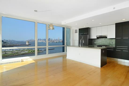 Crystal Point 2 Bed 2.5 Bath, 15Th Floor Waterfront Luxury Condo Corner Unit With Breathtaking Views Of Nyc And Hudson River From Floor To Ceiling Windows. Unit Boasts Gourmet Kitchen W/ Italian Pedini Cabinets, Quartzite Countertop W/ Metallic Tiled Backsplash, Jenn-Air Appliances And A Private Balcony Off The Living Room. Full Amenity Building, Including Pool, Sauna, Gym, Game Room And More. 1 Car Valet Parking Included. Steps To Path Train, Ferry And Schools. Minutes To Manhattan.