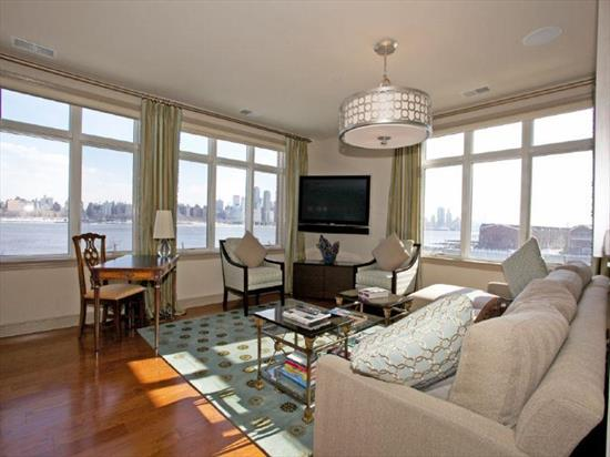 Welcome Home To Your Exclusive 3Br/ 2Bth Home On The Hudson! True Waterfront Living. Open Floor Plan Corner Unit Offers Over 1472Sqft Of Luxury Living With The Best Panoramic Nyc & Hudson River Views From Every Room. Hwfl Throughout, Custom Closets, Tumble Marble Bathrooms, Cherry Cabinets & Granite Counters In Kit. 'Hudson Pointe' Offers A Full Time Concierge, Residence Lounge, Fitness Center, Games Area, Outdoor Pool & Guest Parking. 2 Indoor Garage Parking. Close To Shops, Restaurants & Ny Transportation
