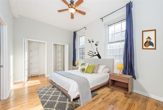 Sun-filled corner unit with a coveted parking space at the primely located historic Dixon Mills community. When entering the unit you will find high ceilings and a long entryway which offers additional privacy. Enjoy the views from the large south west facing windows which gives the space a warm and inviting feeling. This newly painted home has so many great features including custom closets, beautiful hardwood floors, central air, ceiling fan, Bosch washer dryer, SS appliances, a new refrigerator and a new water heater with 12 year warranty. Dixon Mills is a full amenity complex with 24-hr security, concierge, Zipcar and an 8, 000 sq. ft. multi-use lifestyle center with gym, basketball/volleyball court, locker rooms, sauna, screening room and courtyards with BBQ grills. Located a short stroll to the Grove Street PATH, Van Vorst Park, the farmer's market, child and doggie daycare, Citibike and trendy new restaurants and shops. Maintenance fee includes gym, water, gas, onsite super and parking. 675 square feet. This bright and airy corner unit makes the perfect starter home and the location and amenities can't be beat!