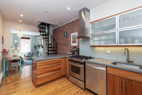 Amazing and rarely available 1412 sq ft duplex with 2 bedrooms, 2 dens, and two full baths in a great Midtown building. This spacious and bright home has a private terrace, in unit w/d, abundant storage, high ceilings, hardwood floors, exposed brick, newer boiler with hot water on demand, and both baths recently redone. Enter the first level and a kitchen you'll love to cook in with solid cherry cabinets and poured concrete countertops, living room with built in bookcases and ornamental mantle, a full bath with washer/dryer, dining room with guest/den area, and charming terrace. The spiral staircase takes you to the second floor with two large bedrooms and French-door den, plus lots of closet space, and newly done bath. Unit has large double storage area and common w/d in basement. Perfectly located for everything that Hoboken has to offer right outside your door, this is also right on the bus line for easy PATH/NY access and near all shopping and local garages.
