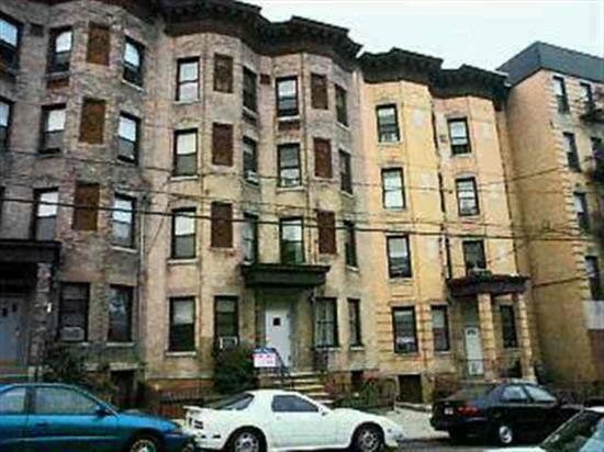 Beautiful Sunny Condo In Historic Bldg Features Wood Floors Bay Window Handmade Kitchen Cabinets & Marble Bath W/Glass Shower Door! Also Enjoy High Ceilings Very Attractive Dld-World Trim/Mouldings New Ge Appliances Use As 1 Br & Den W/Elk Or As 1-Br W/Full Dr Great Qual For Owner Occ Or Invest! Previously Rented 850