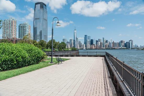 Location, location, location. 126 Dudley is comfortably located in the Paulus Hook neighborhood in downtown, Jersey City, known for its place in American history, family friendliness, laid back atmosphere & pace. Waterfront living has so much to offer the sophisticated buyer, with easy access to Manhattan via 2 NY Waterways ferry stops & ever the convenient Exchange place Path. Commute to Lower Manhattan within minutes. Stroll along the Morris Canal promenade, soak in the iconic Manhattan skyline, the beauty of Hudson Bay and Lady Liberty. Enjoy bike rides, family picnics on the weekends and the occasional jog through Liberty State Park. Trendy restaurants, eateries, local schools, quaint shops and a warm & friendly vibe, makes it the perfect location to call home. Unit 306 is a lovely unit with tons of space, high ceilings, an open kitchen, living & dining room layout, making it easy for entertaining family & friends. Like to cook? This nicely, designed kitchen has ample counter space, gas oven range, stainless steel appliances & a convenient breakfast bar. Utilize wonderful bonus room off the living room & dining room, as a den or an office or simply be creative & suit it to your needs. The master bedroom has great closet space, enjoy the ease & functionality of a double vanity sink when getting ready for work in the morning and the luxury of choice with the stand up shower & soak in bath tub. 126 Dudley originally built & completed by Khov in 2006, the complex was soundly built with quality modern finishes & materials, it comes equipped with a great gym located on the first floor for burning off the calories, a common outdoor yard with lounge tables, chairs and grilling stations for summer fun. Unit 306 has a parking spot in the secured garage. Tax abatement runs until 2026. Come see why you should call 126 Dudley home.