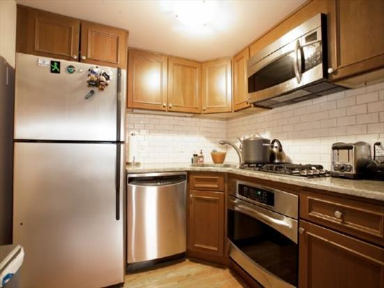 Seller Says Sell! EXCEPTIONAL Location, Condition, Value! Renovated, impeccably-maintained, corner 1BR/1Bth w/ optimal use of space STEPS TO PATH! Showered w/ brilliant SE light, enjoy sunrise & Downtown NYC vus from peaceful BR. Open, inviting LR w/ soaring ceilings, wd flr, 9 windows w/ custom blinds, Gleaming Chef's Kitchen complete w/ tiled backsplash, granite cntrs, ample cabinetry, SS appliances. Phenomenal storage incl deep overhead attic space & closets. Parking in municipal garage.