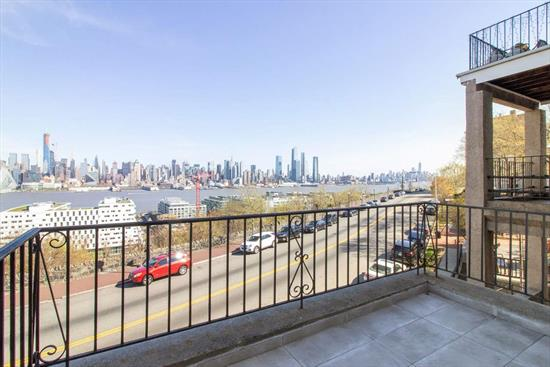Enjoy stunning panoramic NYC views from your private balcony on the most desired street in Weehawken. This beautiful 3 bed/1.5 bath condo offers a spacious open layout with contemporary finishes. Features include granite counter tops, stainless steel appliances, dishwasher, modern ceiling fans, hardwood floors throughout, laundry in unit with the convenience of a (1yr) new HVAC system. It's location completes this package with bus to NYC on the corner, close to ferry, shops, light rail, parks and restaurants.
