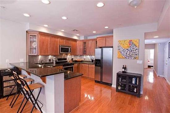 IDEAL LOCATION - steps to NYC Bus, PATH, & Washington St . Take the elevator up 1 flr to this home that features an open layout w/ great natural light. The open kitchen features granite counters, custom cabinets, SS appliances, bfast bar & dining table. The master bedroom features a full bath & walk-in closet, 2nd bedroom fits a queen bed, but would also make a great office/nursery. Enjoy the gas fireplace in the winter & the juliette balcony in the summer. Built in 2007, this is the 1st resale in the bldg.