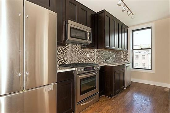 Newly renovated 2 bed 1 bath located on one of Hoboken's most desirable streets. Amenities include beautiful hardwood floors, modern kitchen with granite counter tops, SS appliances, gracious floor plan, central air/heat , and washer/dryer in unit. Easy access to NYC transportation and Hoboken restaurants.
