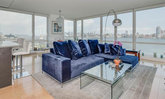 A Rare Opportunity! 42 Story Glass Building Offers 3 Bed, 2.5 Bath, Ne Corner Unit With Panoramic Nyc View From Gwb Bridge To Verrazano Bridge .Enjoy This View From Wrapped Around Floor To Ceiling Windows & Outdoor Terrace.1591 Sq Ft Unit Features All Hardwood Floor Through Out, Elegantly Designed Kitchen With Top Of The Line Finishes Include Jennair Appliances, Italian Pedini Cabinets And Quartzite Counter Tops. Marble Bathrooms Add More Elegance To The Unit. Building Features 24 Hrs Concierge Service , Community Room With Kitchenette, Outdoor Pool, Indoor Jacuzzi, Steam Room& Sauna, Gym, Game Area And Screening Room, Outdoor Patio With Fire Pit. Close To Path Stations And All Other Transportation To Nyc.
