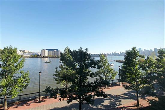 Fantastic midtown and Hudson River Views. Welcome to the Hudson Tea, one of Hoboken's most sought after waterfront communities. Home features include fantastic view, 12ft vaulted ceilings, 10 ft picture windows, granite counters, ss appliances and hw floors throughout. Community features 24 concierge, 2500 sqft state of start gym, and community room. Commuter's dream...ferry blocks away or take private shuttle to the path. 1 parking spot in parking deck included.Open House 11/23 1-3