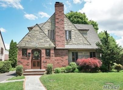 MAGNIFICENT 4 bedrm, 3.5 bath Tudor located in the desirable Plandome Heights. This stunning home features xtra large LR w /wfplc, Banquet Dr with french doors opening to family rm w/radiant heated floor, EIK with slidg. doors overlooking beautiful patio. Spacious Master Suite w radiant heated floor in bath. Finished basement with rec. room 1.5 car garage. All this and Much more sitting on parklike grounds!!!!!!
