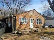 Sooooo much potential in this light & bright ranch on a quiet street close to all in Calverton! Needs TLC but has lots of possibilities & is perfect for 1st time buyers or handy people! Large living room with wood burning stove, eat-in kitchen, 2-3 bedrooms (3rd bedroom is being used as a laundry room), full bathroom, updated windows & roof, gas propane heating, large detached garage, 60 x 126' property backing woods and low, low taxes of $5, 469.25!