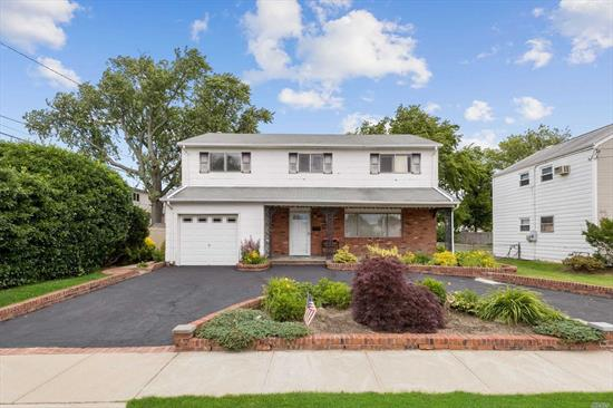 Excellent 4 Br & 2.5 Bth Colonial Home w/circular Driveway & front open porch in the desirable Barnum Isle section of Island Park. Not in Flood Zone. Large LR w/Open layout to FDR & Large EIK w/pantry. Gleaming Parquet HW Floors thru-out. Huge MBR Suite w/FBth & WICs plus 3 additional Large Brs & Full bth on 2nd Floor. Beautiful Backyard w/brick elevated patio, Att Gar, Gas heating. Low Taxes. Commuters Delight only a few blocks to the LIRR. Near schools. shops, transportation, beaches.